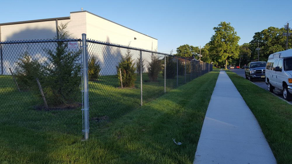 Fencing on grass outside of AAA Hobbies & Crafts building