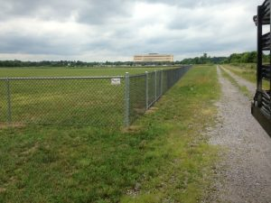 Fenced in Washington Township Soccer Field corner next to dirt path